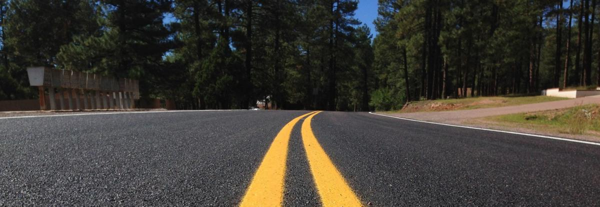 Scenic roadway with yellow stripes