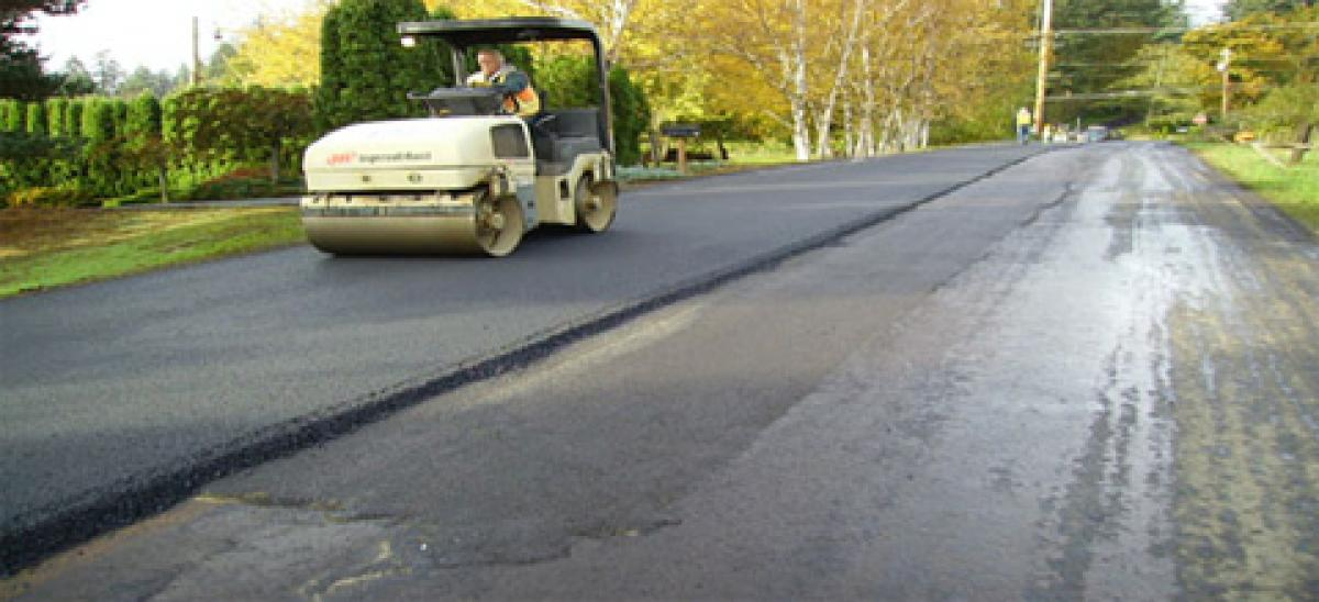 Man repaving a road